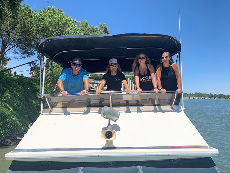 Big Valley Mortgage Loan Officer Karen Dunn on a boat with her family.