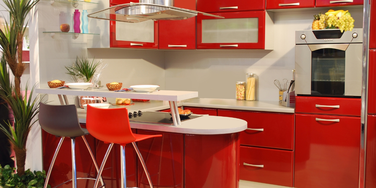 Photo of a kitchen painted mostly in red with red furniture and accents.