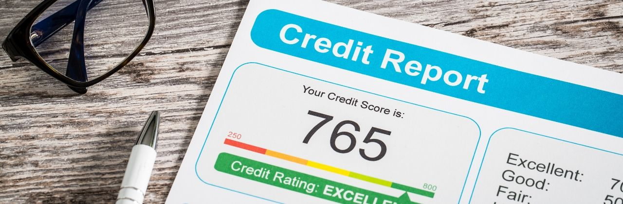 Photo of a credit report displaying an excellent credit score of 765.
