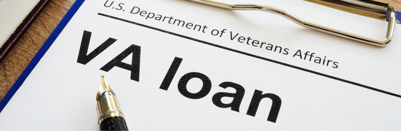 Photo of a VA loan form on a clipboard.