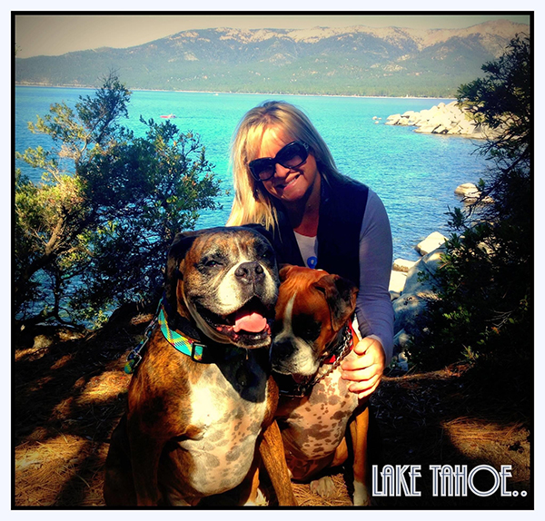 Juliette Brossard posed with her two pet dogs in front of a gorgeous view of the lake and mountains