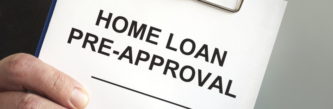 "Image of a person holding clipboard with a paper attached with text that reads ""Home Loan Pre-approval"" typed in all caps."