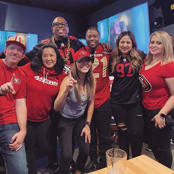 Klare Vue posed with friends all in 49ers gear.