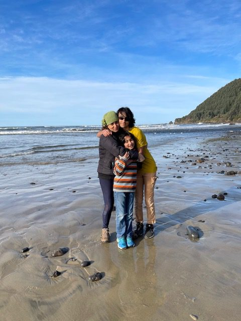 Big Valley Mortgage Loan Officer, Gorda Zafari, with her family on a camping trip posing on the beach.