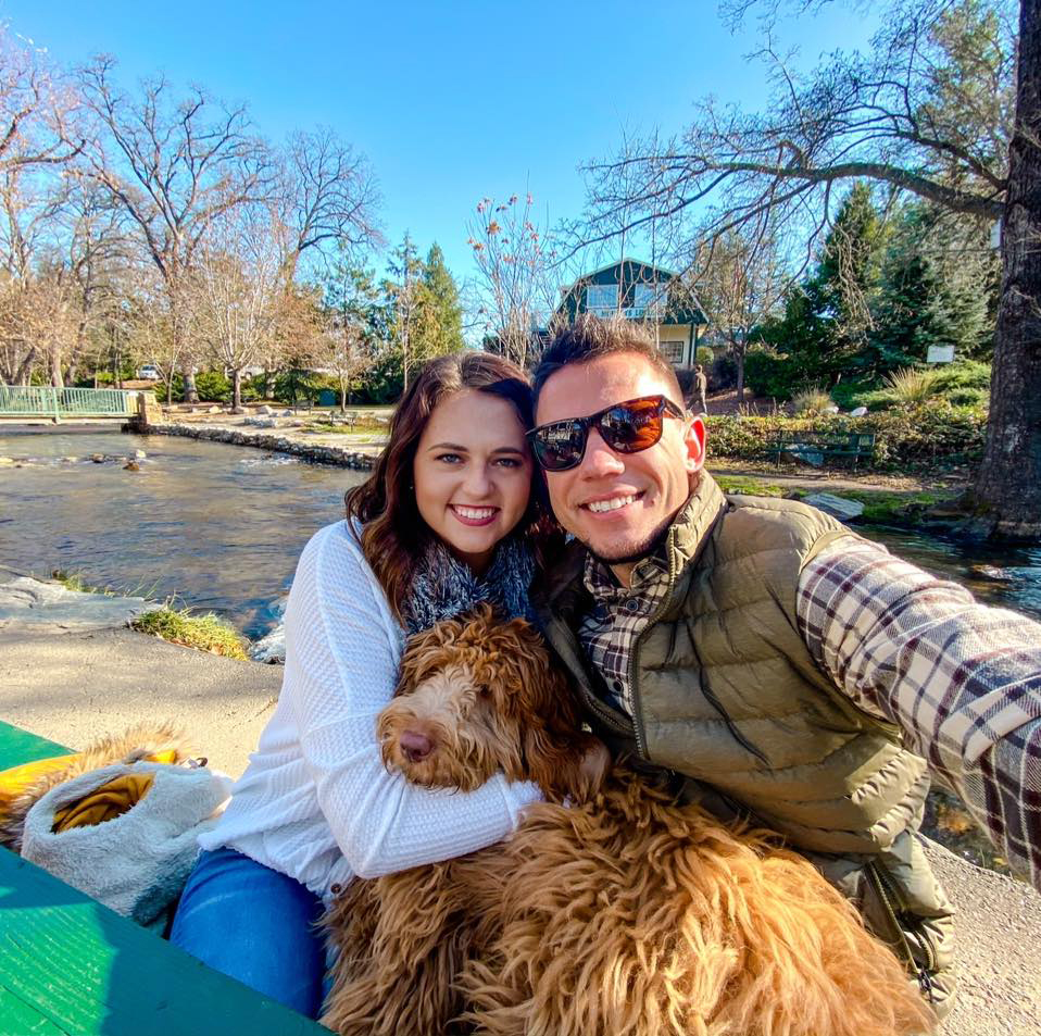 A photo of Chelsey Ovenell with her husband and dog.